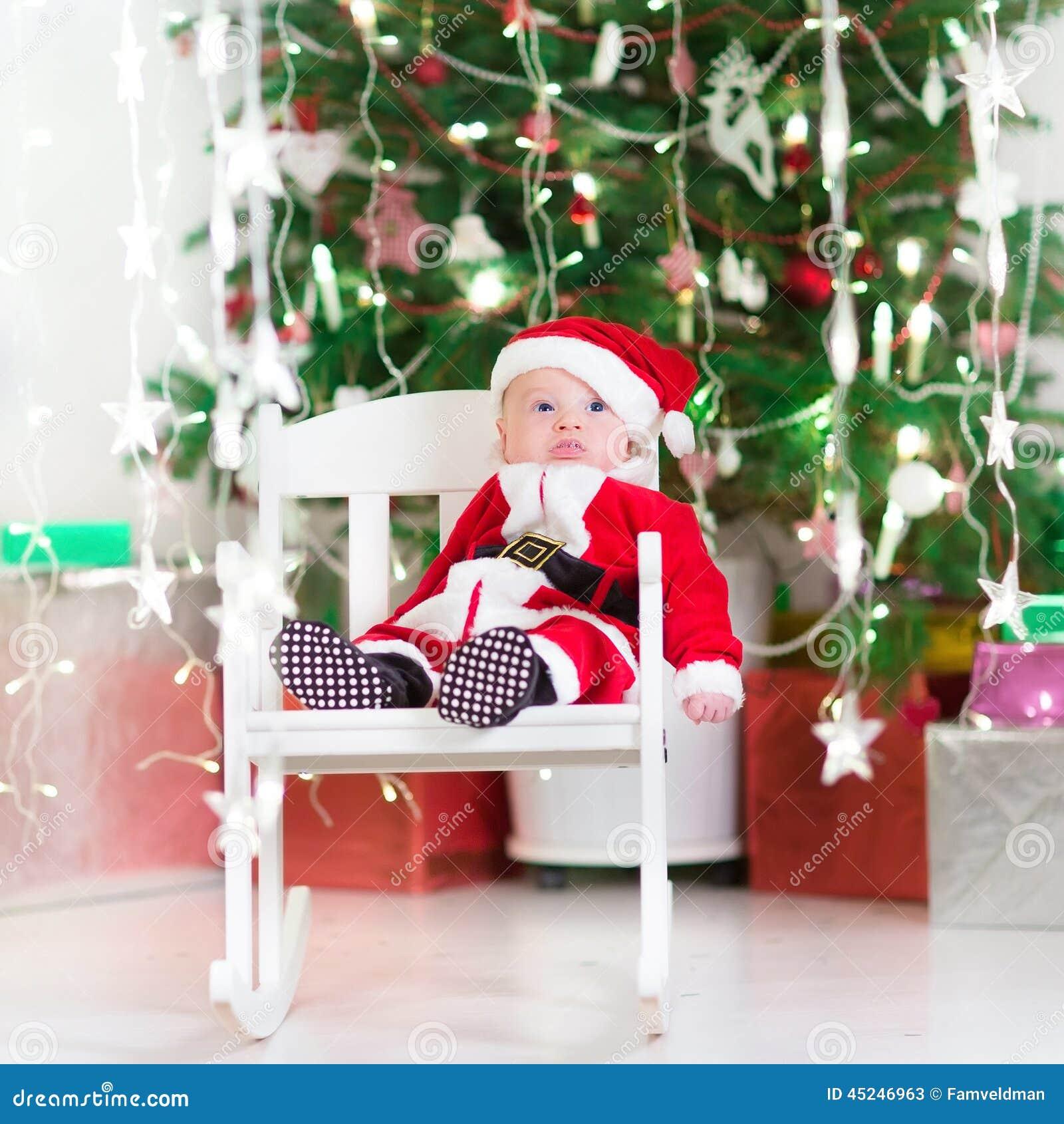857008c73af4 Sweet Newborn Baby Boy In Santa Costume Under Christmas Tree Stock ...