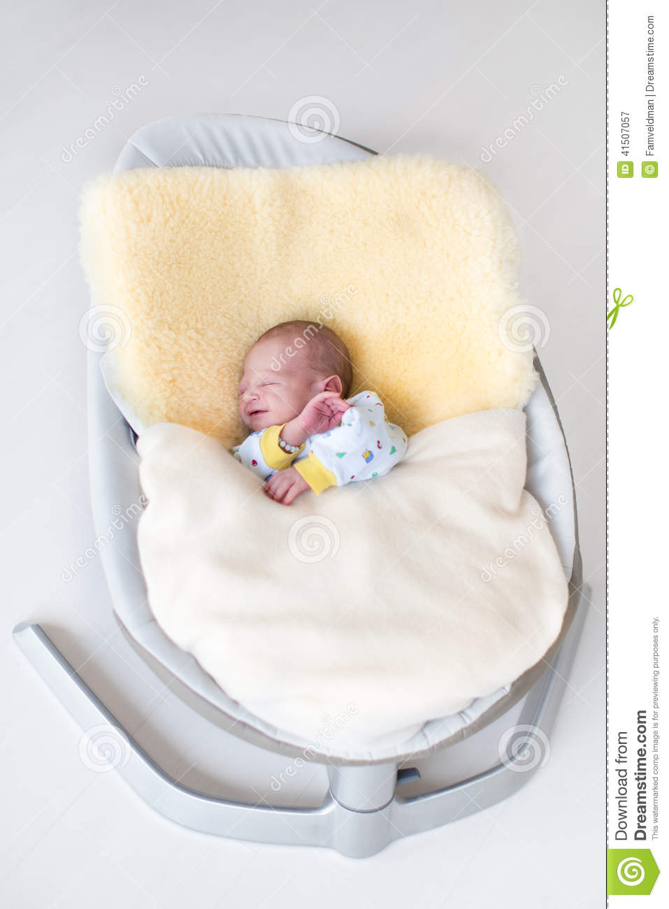 Sweet Newborn Baby Boy In Swing On A Sheepskin Stock Photo
