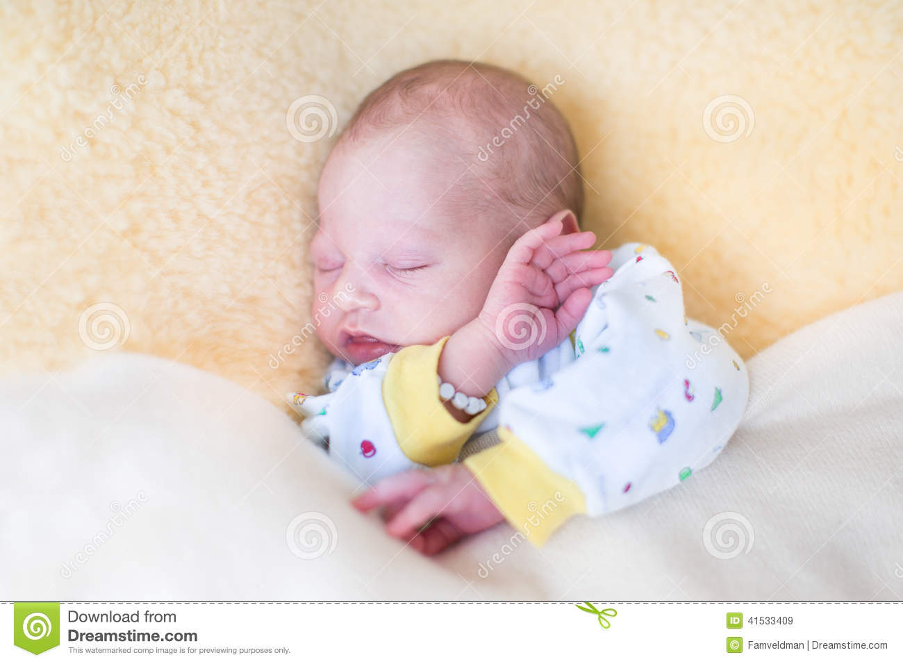 Sweet Newborn Baby Sleeping On Warm Sheepskin Stock Image