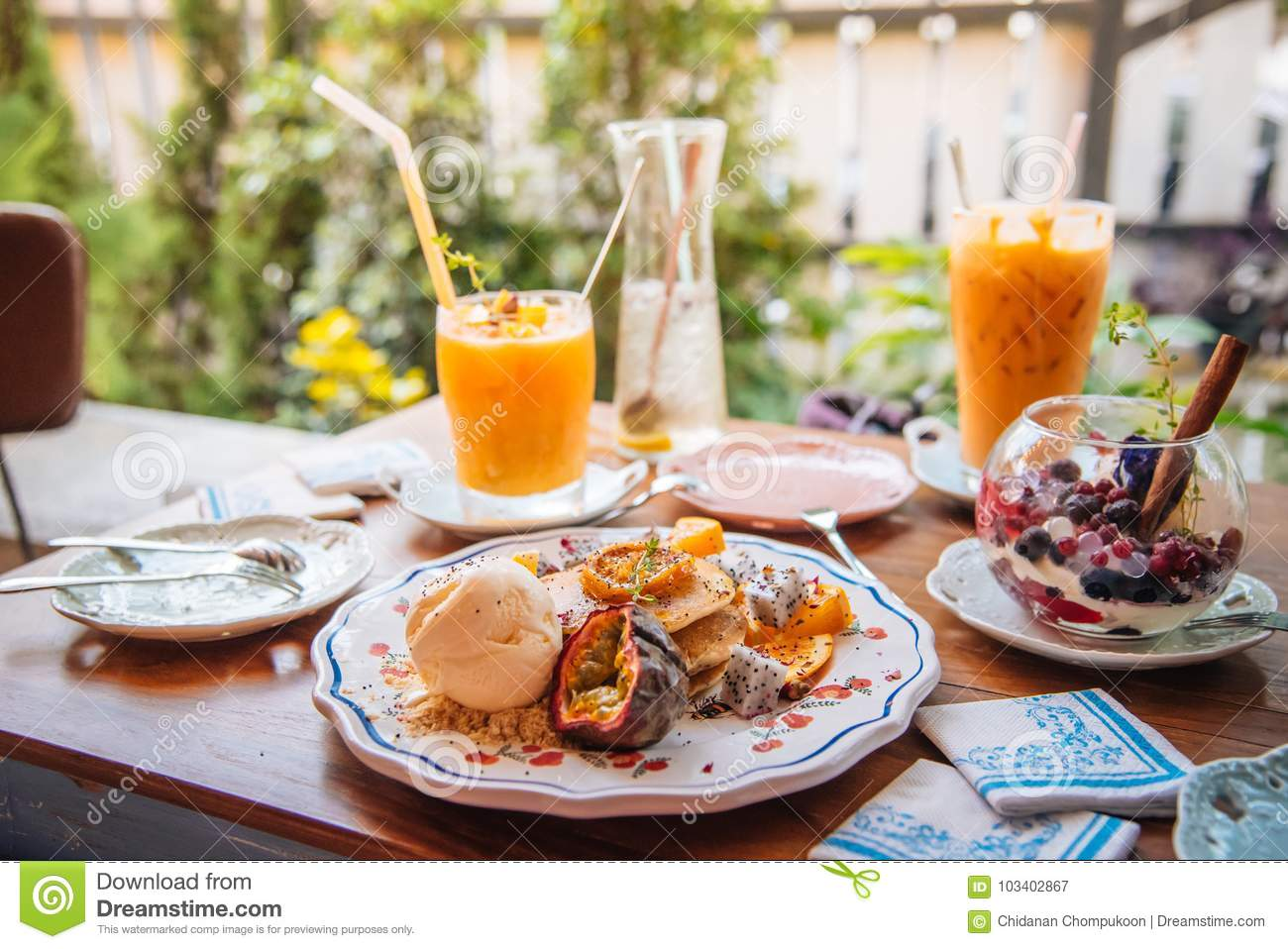 Sweet Pancakes with honey and vanilla ice cream Fruit with Orange focus on pancake