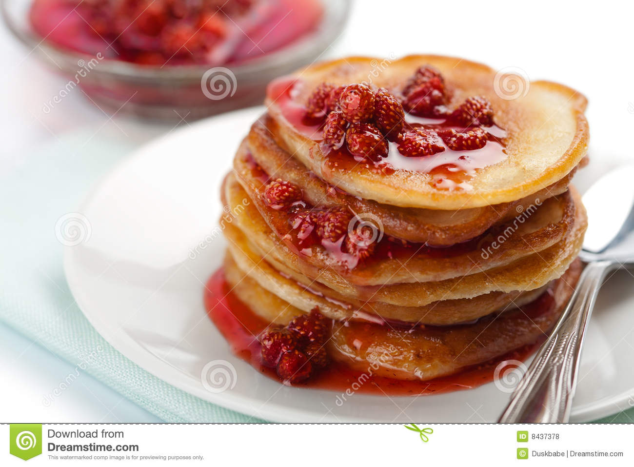 Sweet pancakes with strawberry jam isolated