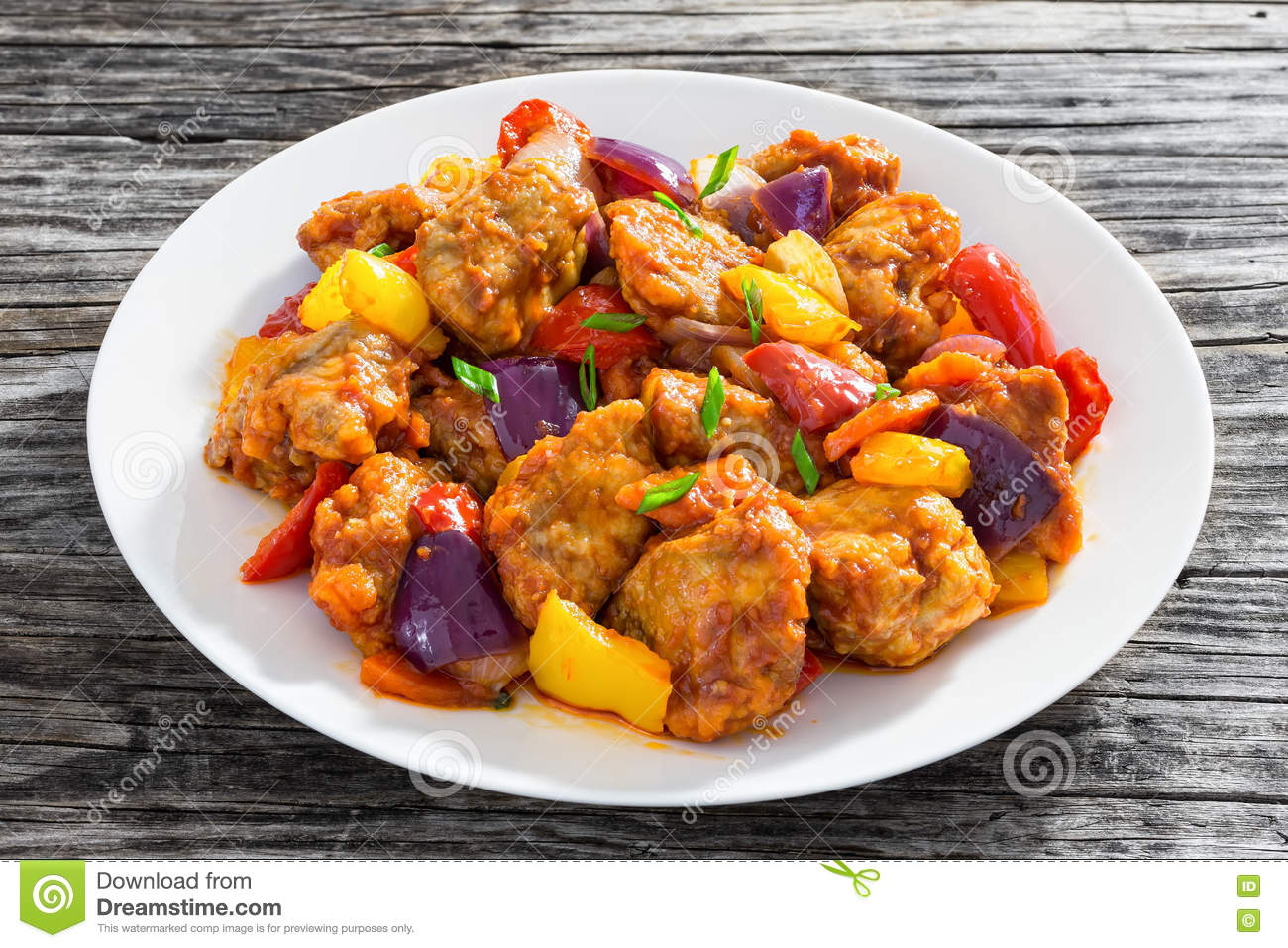 Sweet And Sour Fried Pork Chunks With Vegetables Stock Photo