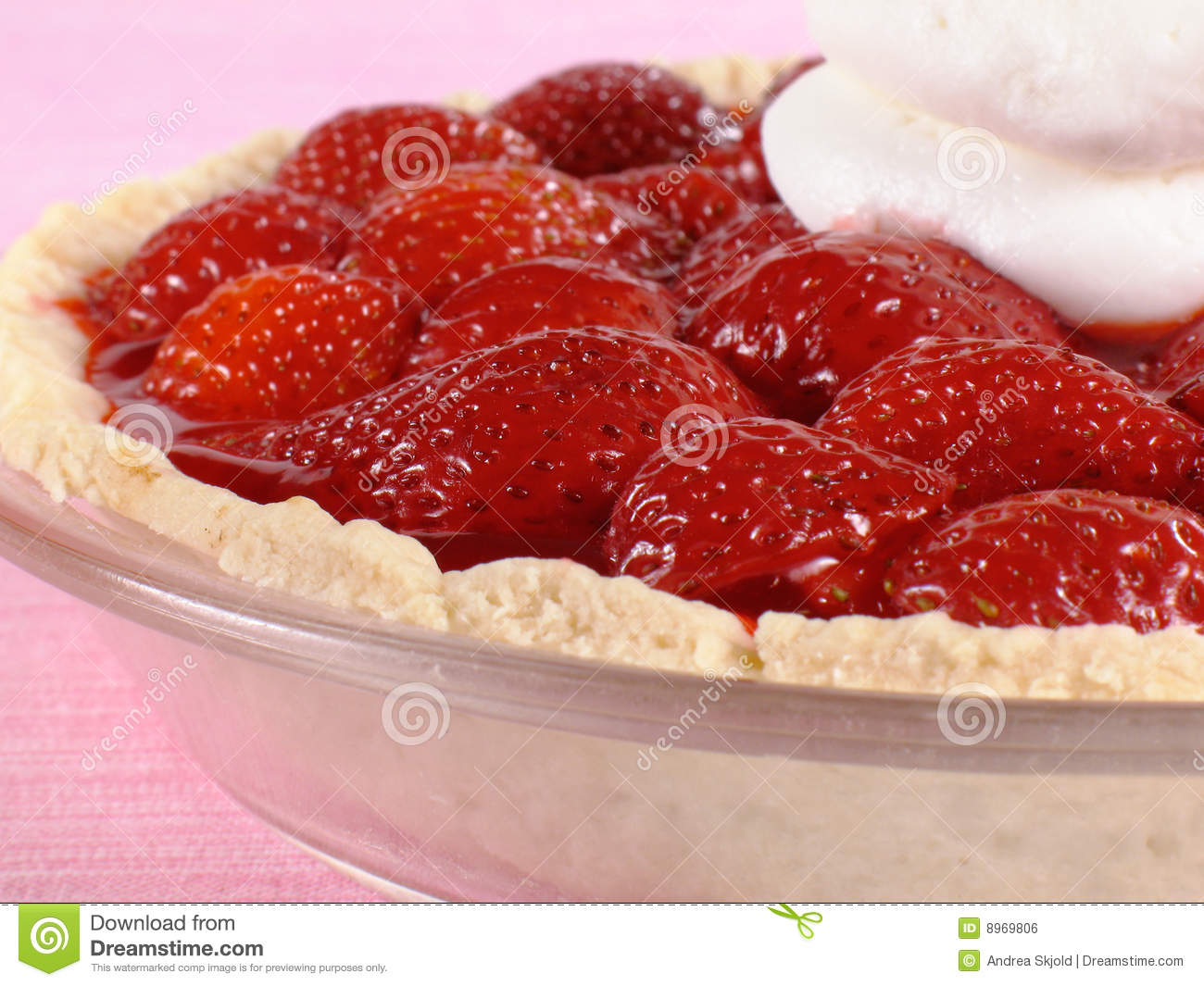 Deliciously sweet strawberry pie with whipped cream.