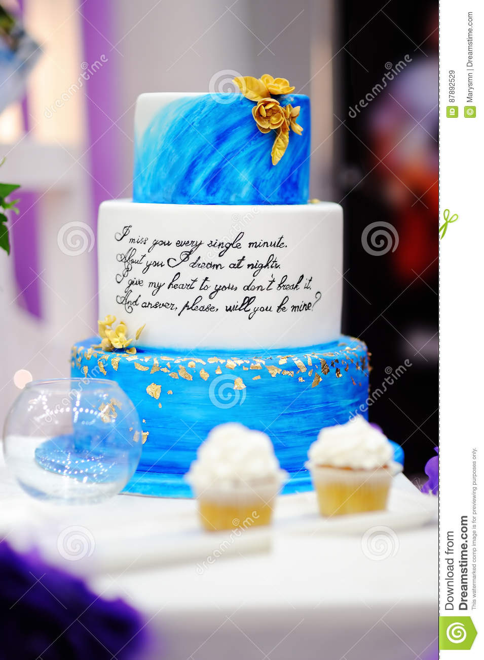 Sweet Table Set With Blue Cake And Cupcakes On Wedding Party Stock