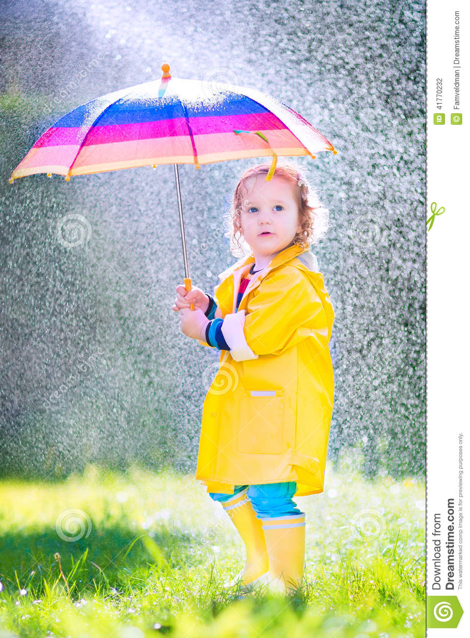 Sweet Toddler With Umbrella Playing In The Rain Stock ...