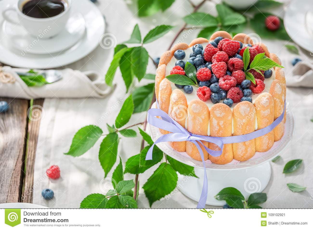 Sweet yoghurt cake with raspberries and blueberries in garden