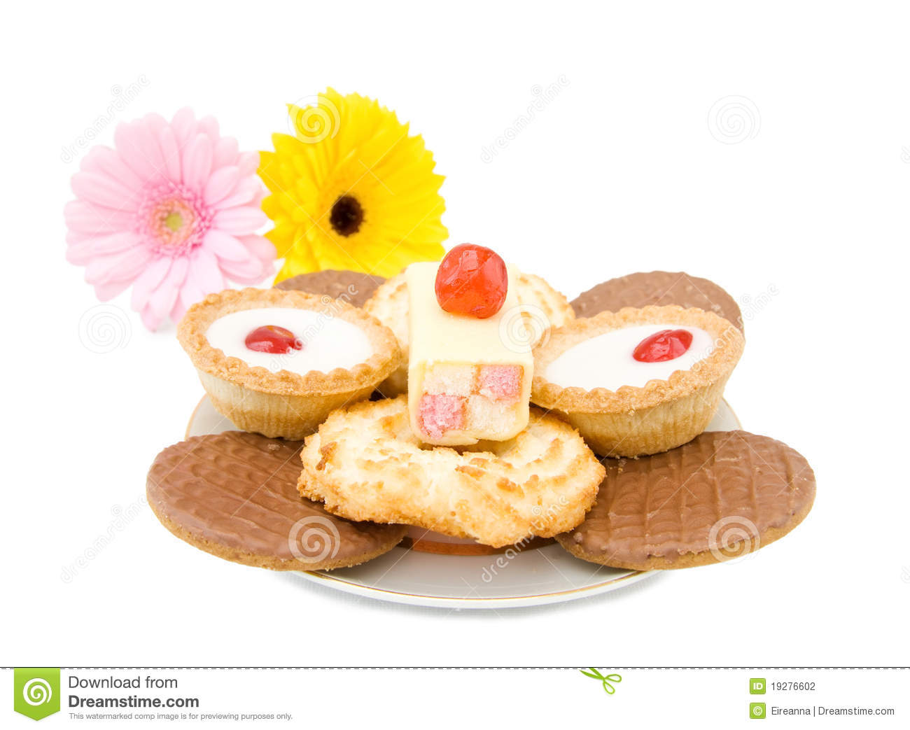 Dessert plate with chocolate biscuits, vanilla cakes and cherry ...