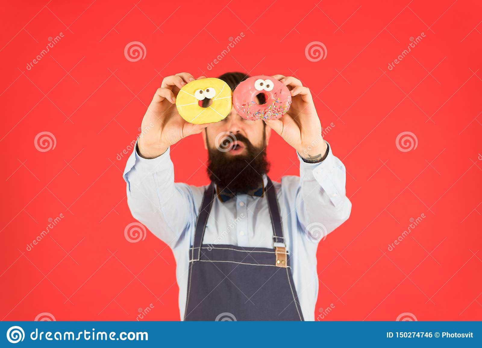 Sweets and cakes. Junk food. Hipster bearded baker hold donuts. Eat donut. Cheerful mood. Doughnut calories. Glazed