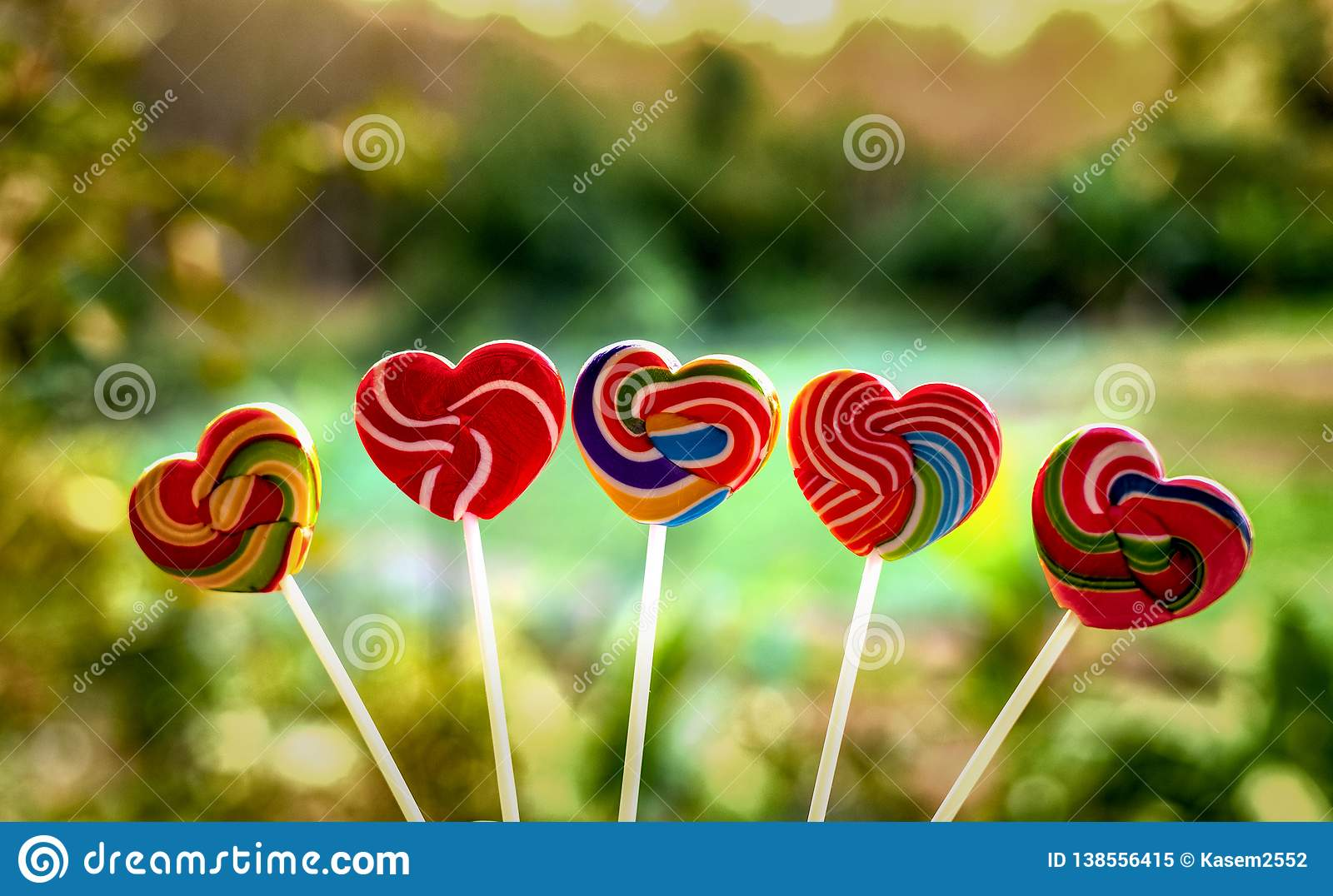Sweets candies heart shape color full on blurred background, Set candy of color rainbow lollipops, Gift for Valentine day