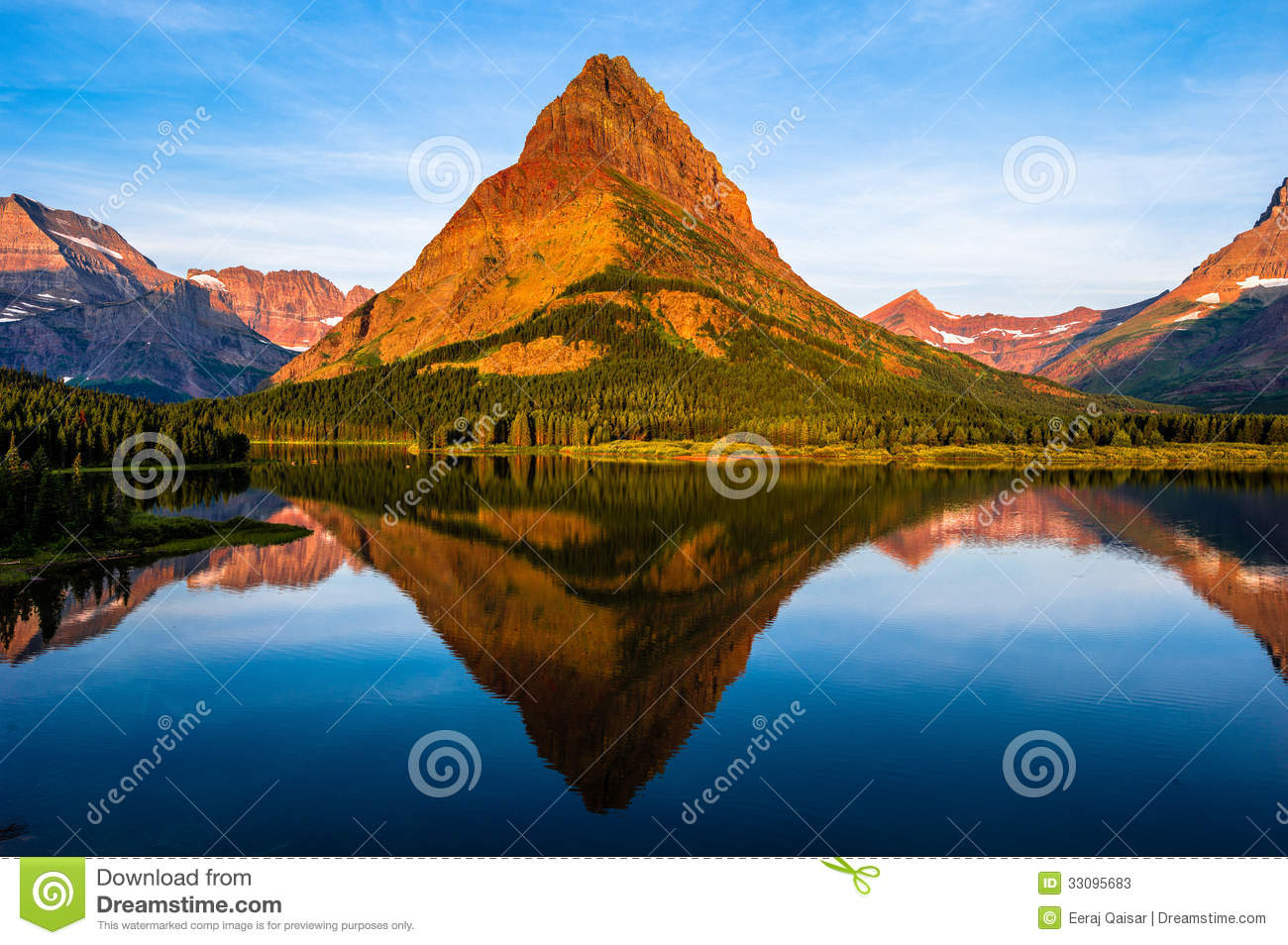 Dawn at Swiftcurrent lake in Montana's Many Glacier National Park ...