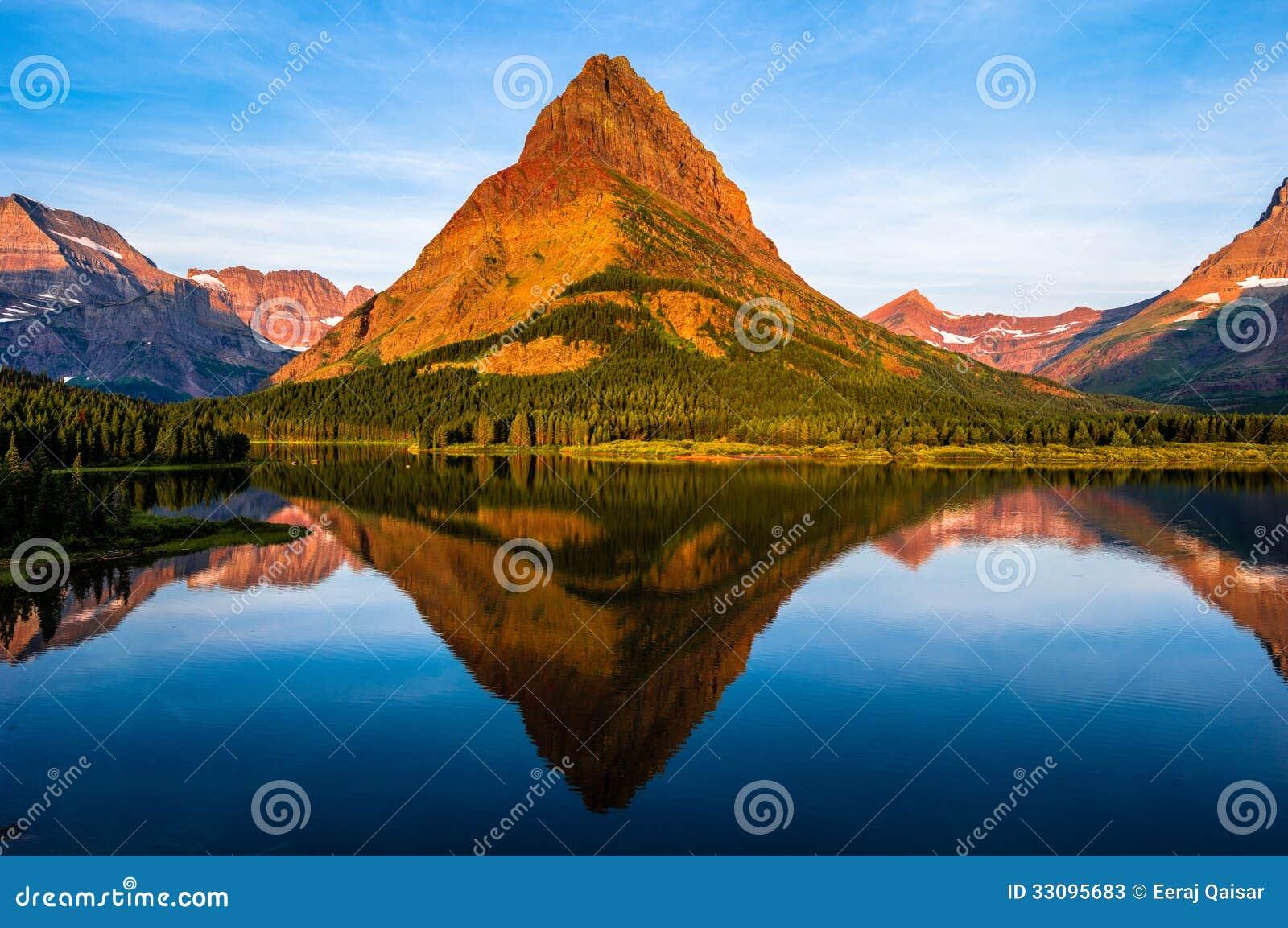 swiftcurrent lake sunrise montana stock image image of lake