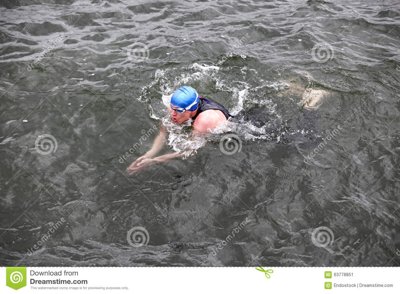 Swimmer In Cap And Wetsuit Performing The Breaststroke In ...