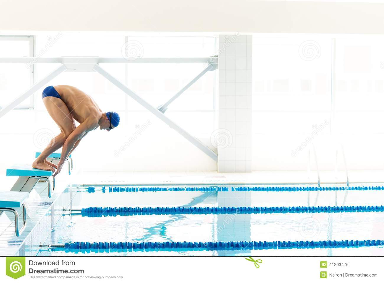 swimmer jumping from starting block i stock photo image of block lane 41203476. Black Bedroom Furniture Sets. Home Design Ideas