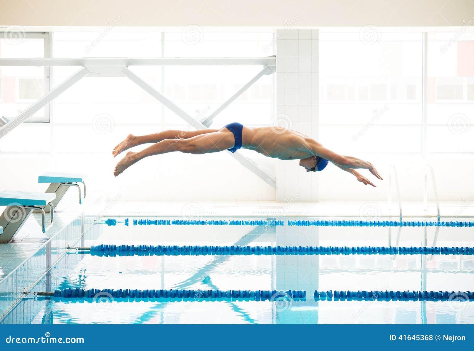 Swimmer jumping from starting block stock photo image 41645368 - Olympic swimming starting blocks ...