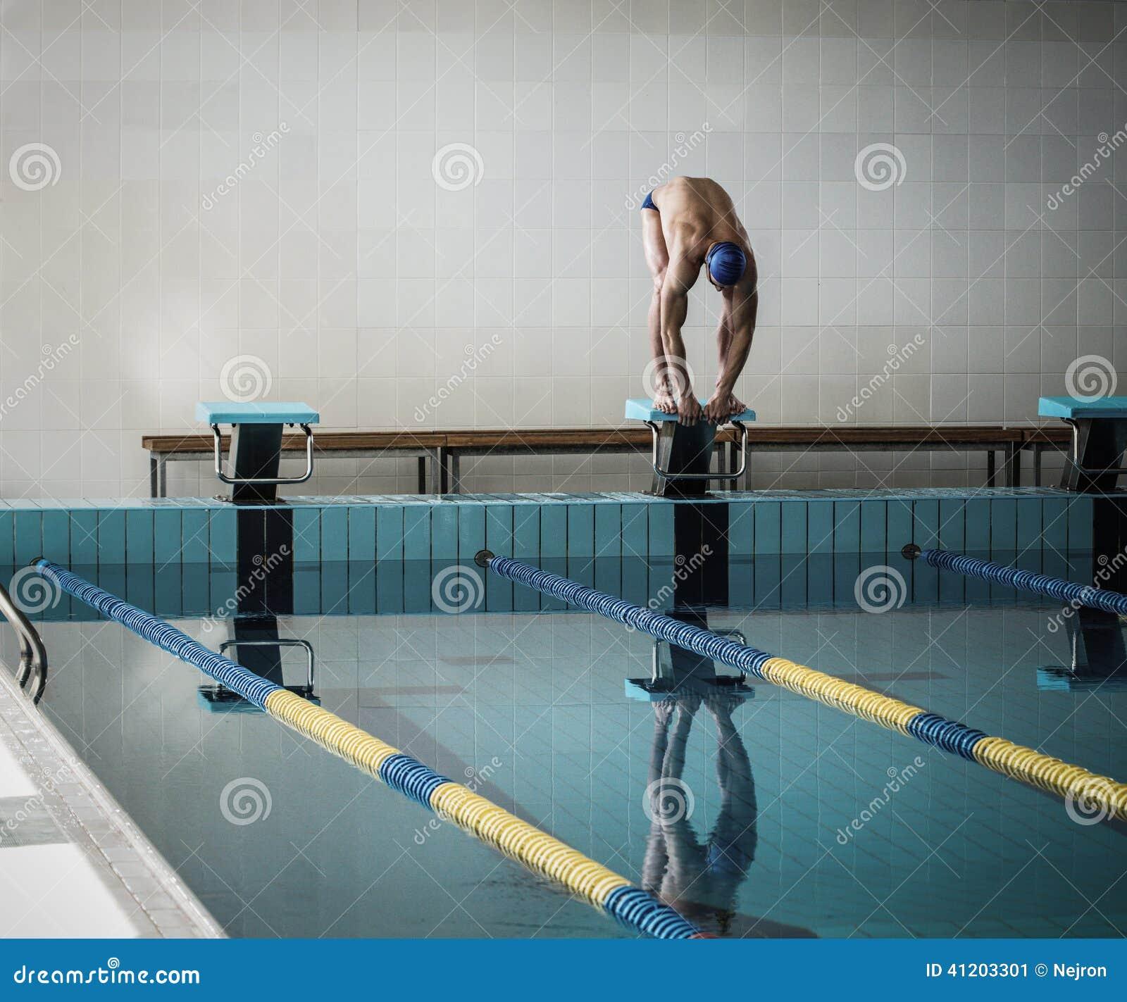 swimmer standing on starting block stock photo image 41203301. Black Bedroom Furniture Sets. Home Design Ideas