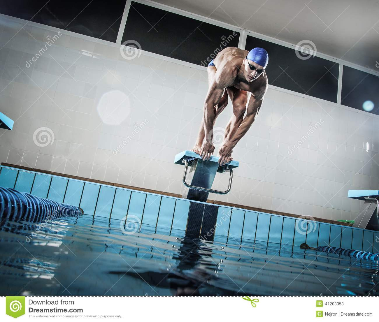 Swimmer Standing On Starting Block Royalty Free Stock Photography 41203301