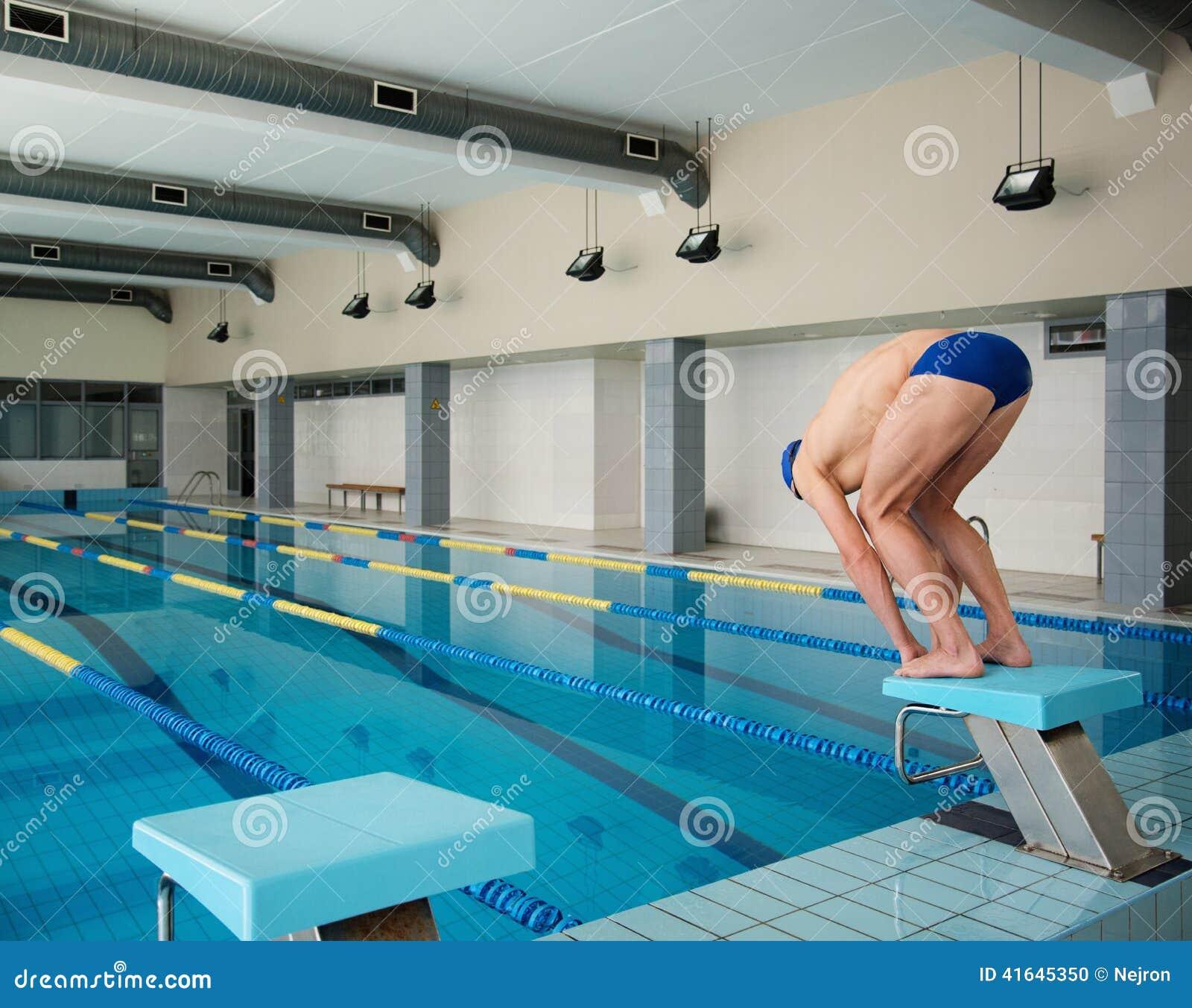 swimmer standing on starting block stock photo image 41645350. Black Bedroom Furniture Sets. Home Design Ideas