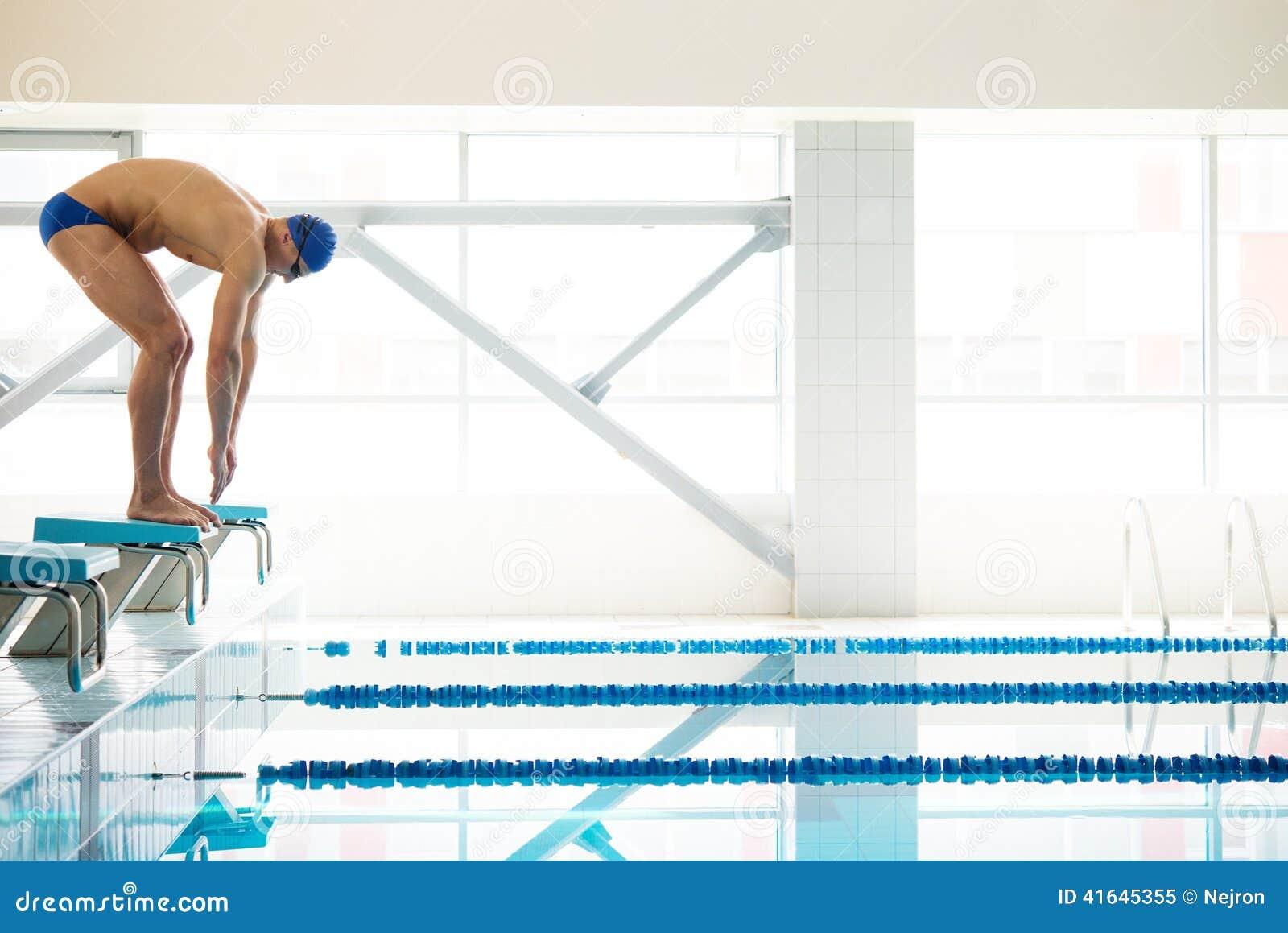 swimmer standing on starting block stock photo image 41645355. Black Bedroom Furniture Sets. Home Design Ideas