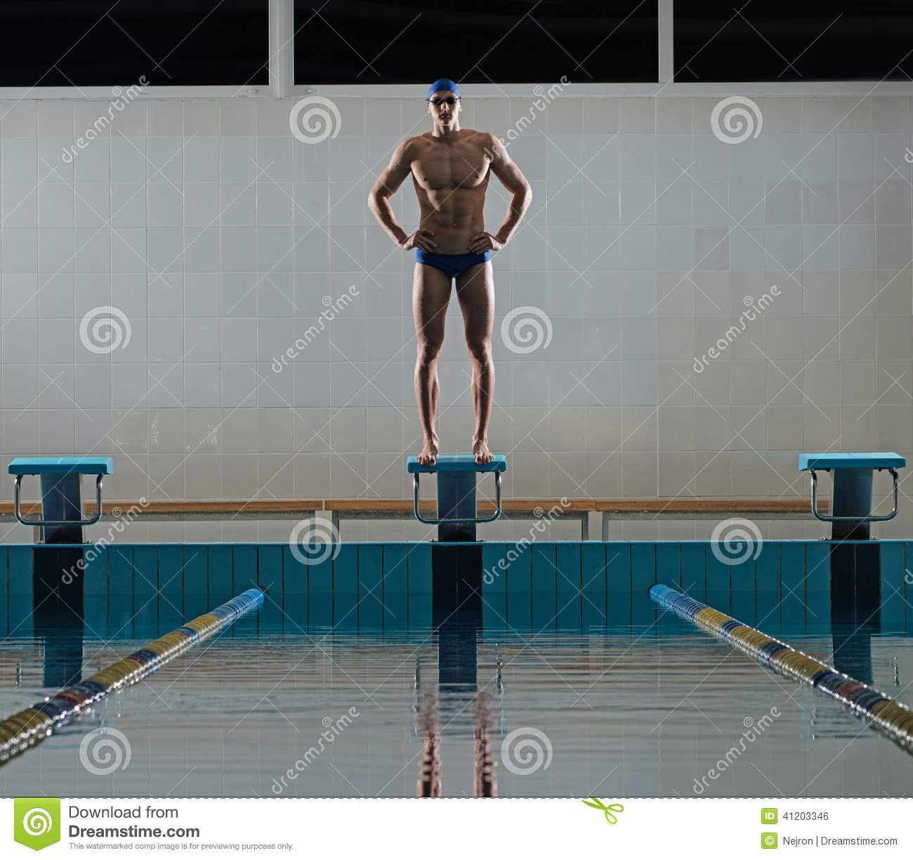 Olympic Swimming Pool In Person: Swimmer Standing On Starting Block Royalty-Free Stock