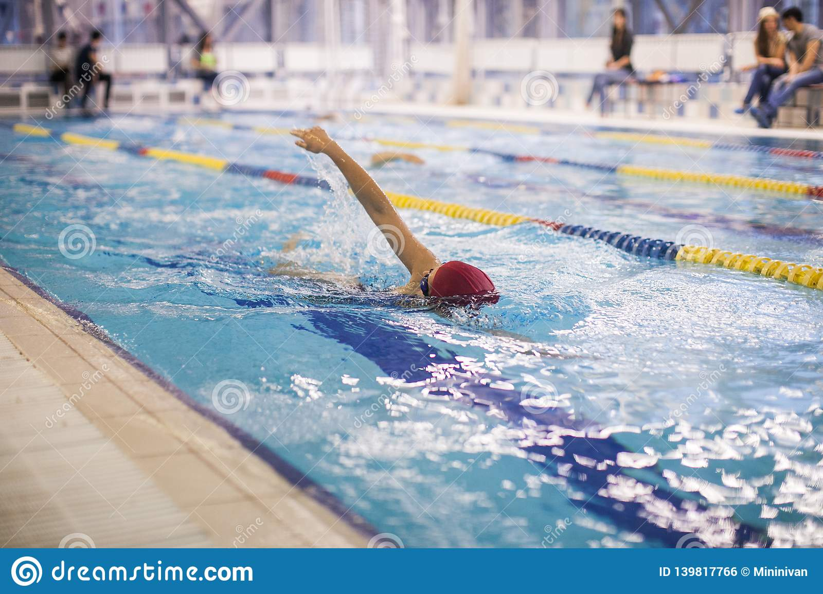 A Swimmer Swimming The Front Crawl In A Pool