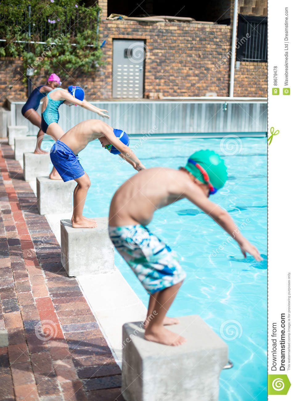 swimmers taking position to jump in swimming pool stock photo image of leisure caucasian. Black Bedroom Furniture Sets. Home Design Ideas