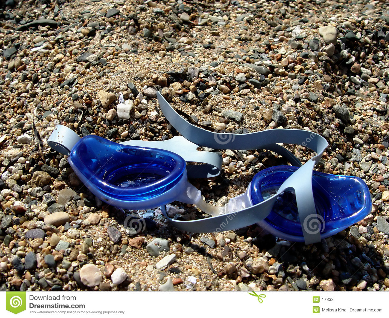 Swimming goggles on sand