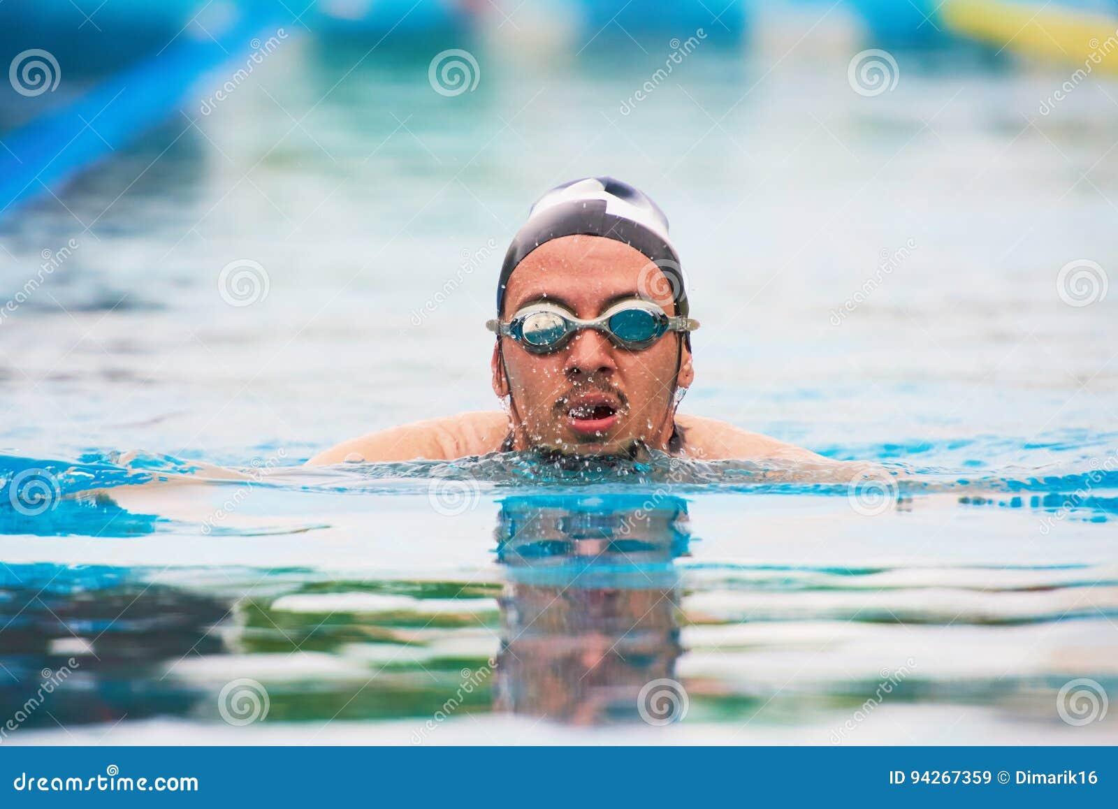 Swimming man in pool