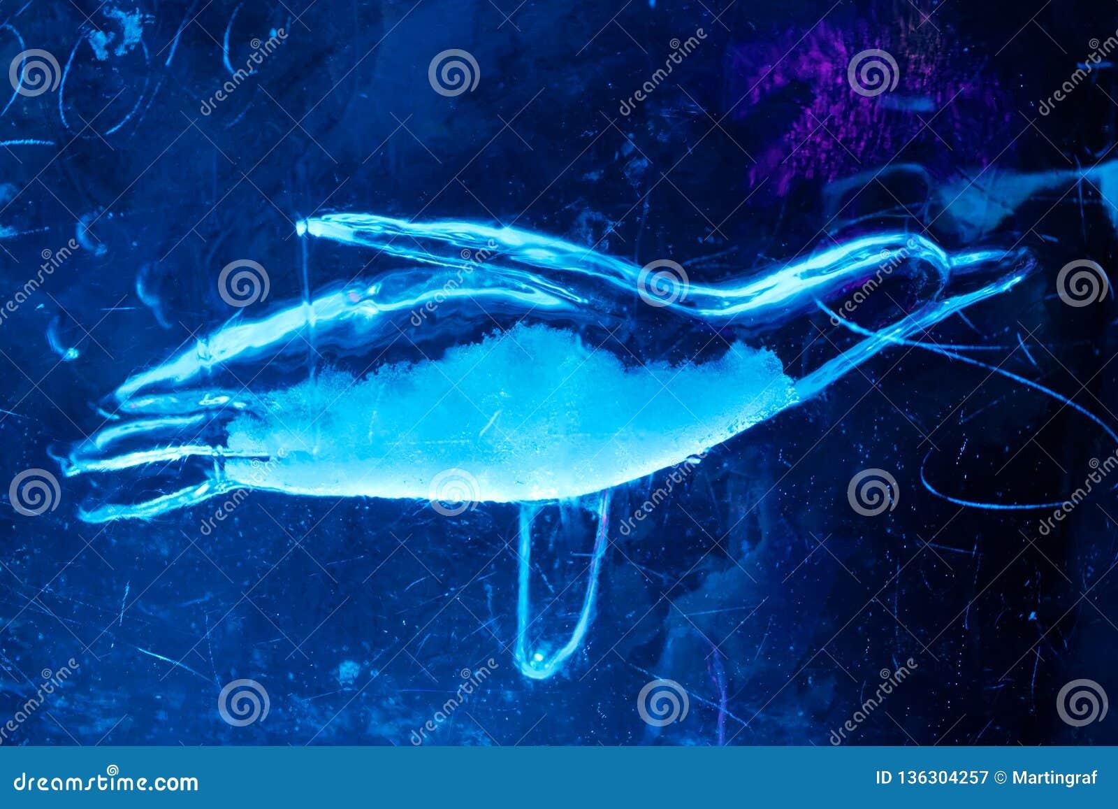 Swimming penguin ice sculpture underwater world art