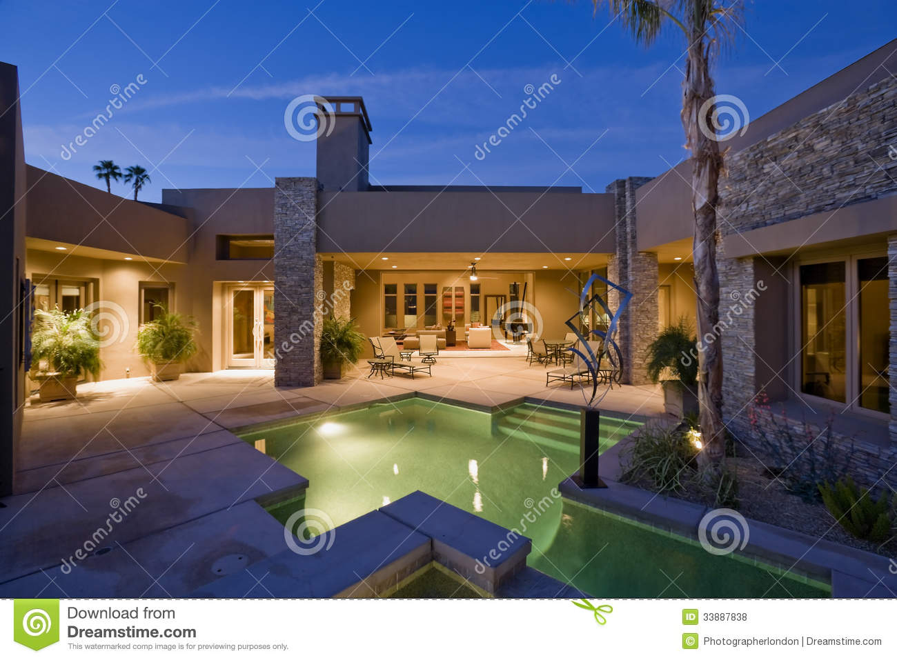 Swimming pool against modern house royalty free stock for Modern house front view