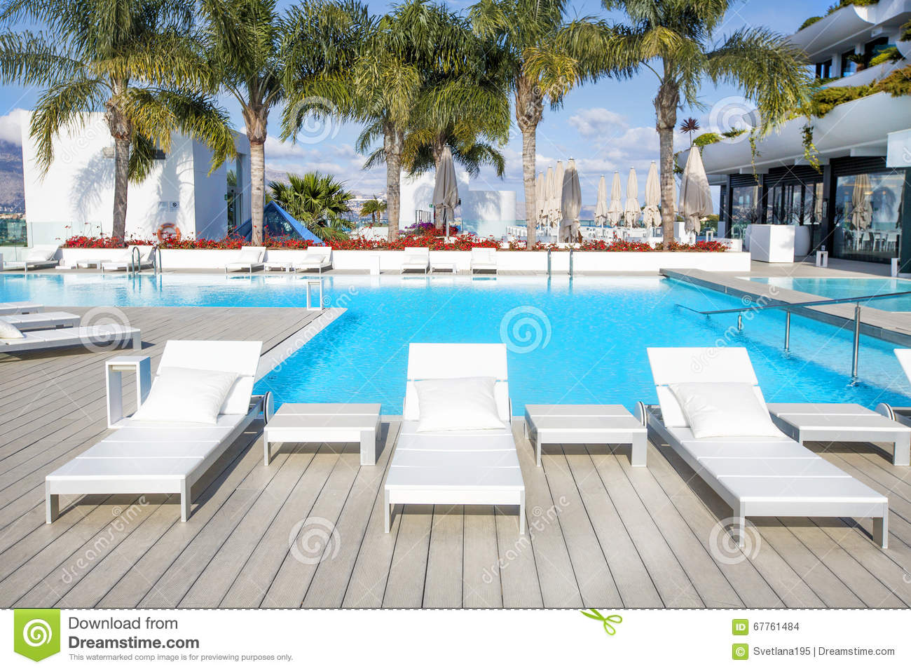 Swimming pool area with white sun beds at the modern for Swimming pool area