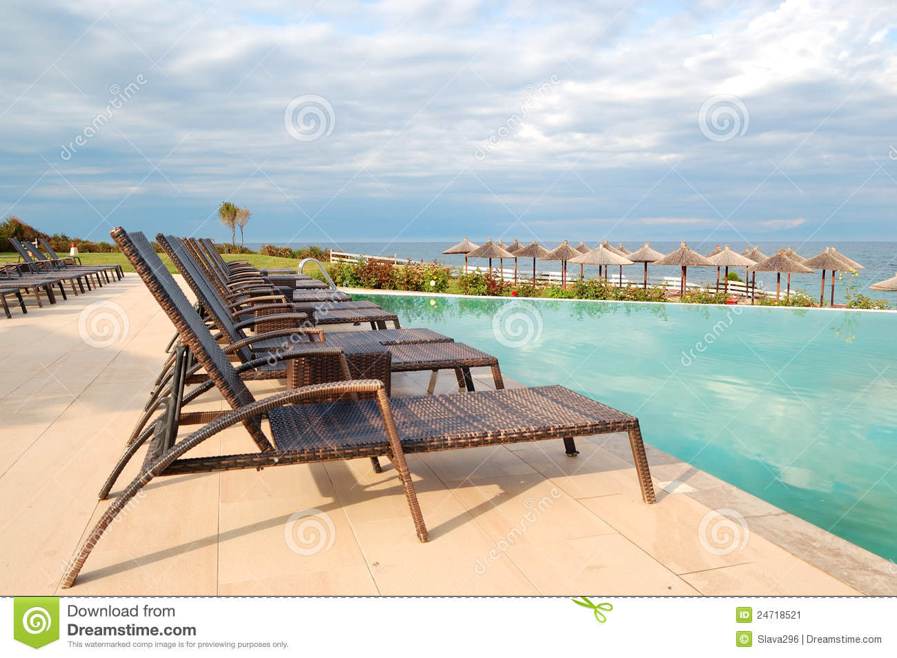 Swimming Pool By Beach At The Modern Luxury Hotel Stock