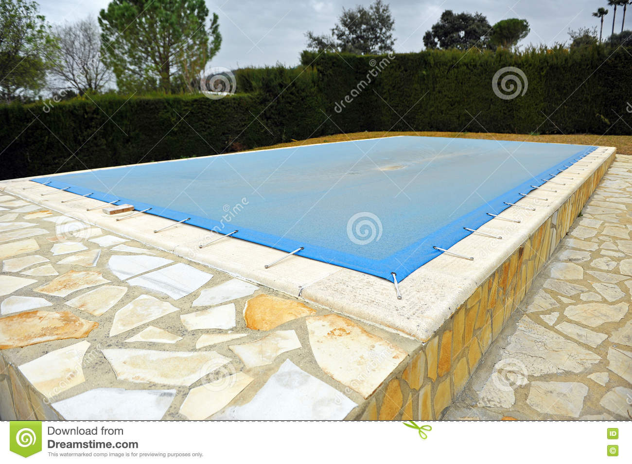 Swimming Pool With A Blue Tarp For Protection In Winter ...