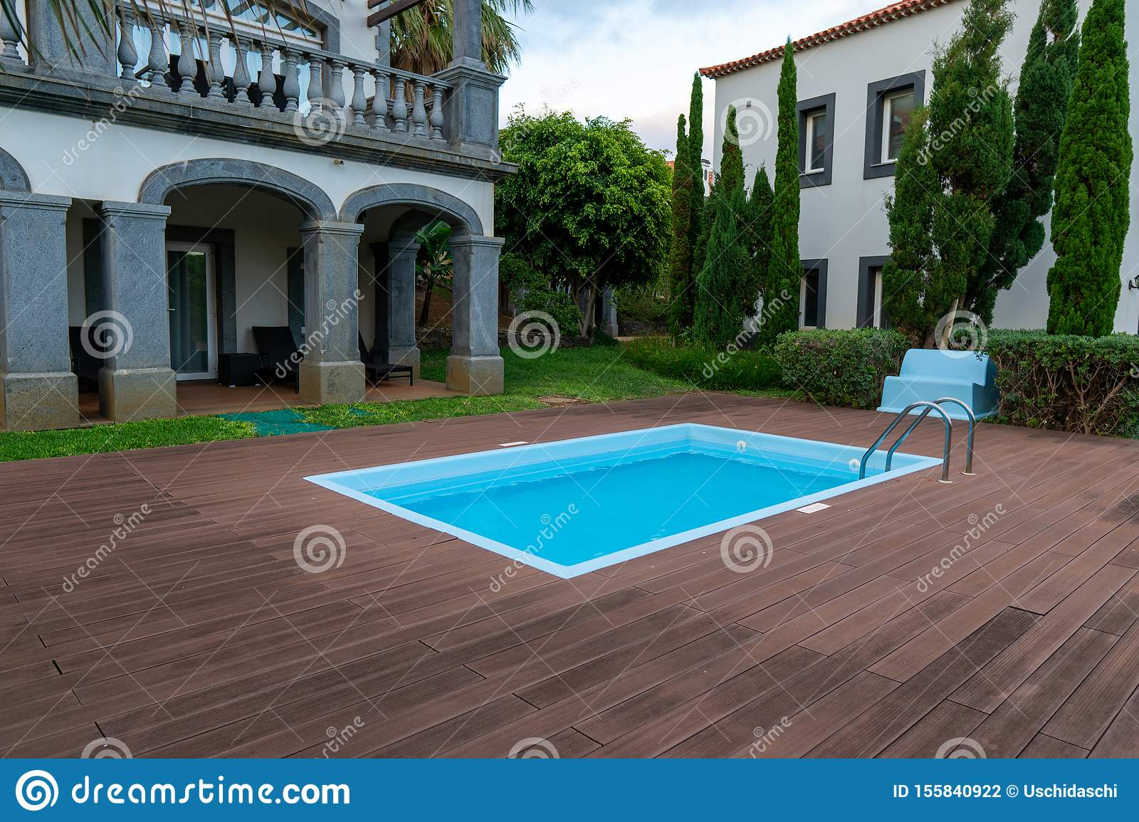 Swimming Pool Design With Wood Deck And Modern Villa Stock Photo Image Of Garden Estate 155840922
