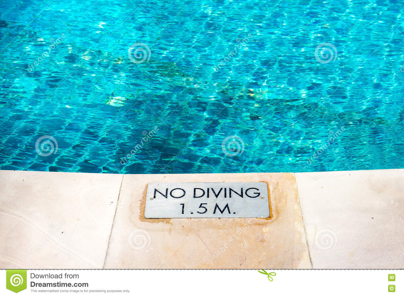 No Swimming Pool : Swimming pool edge with `no diving` warn sign stock photo