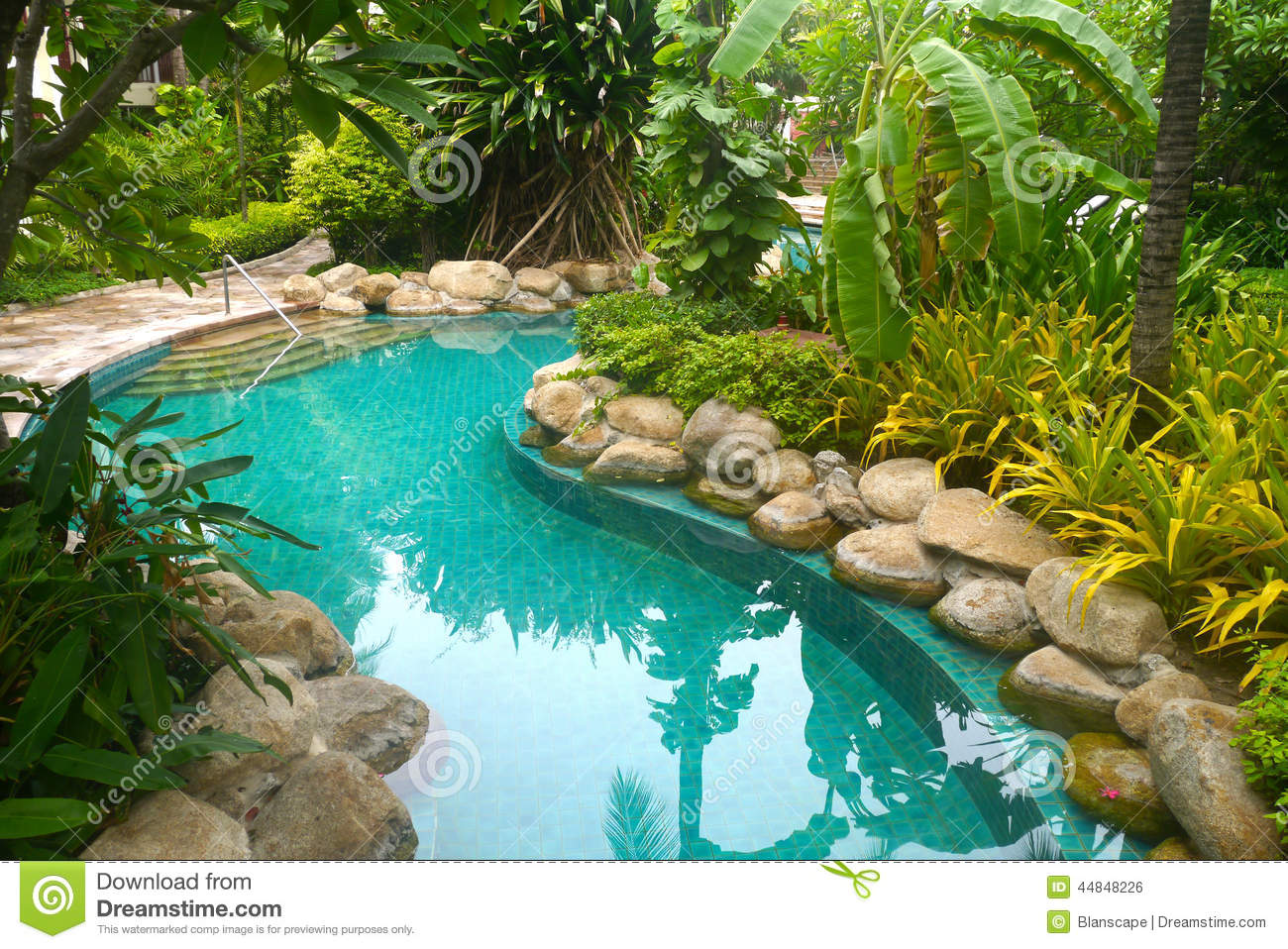 Swimming pool with garden decoration stock photo image for Alma de agua jardin de eventos