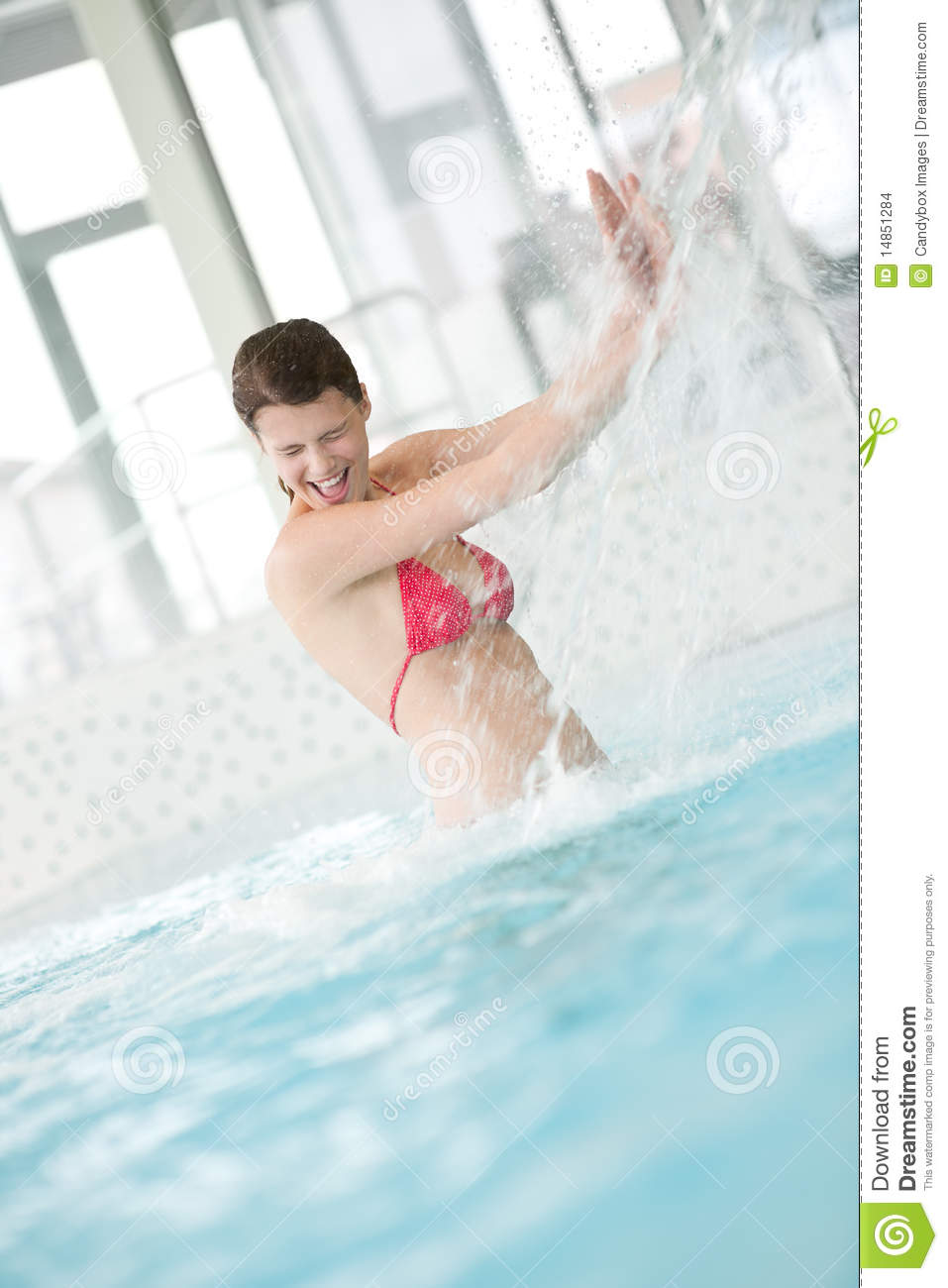 Swimming pool - happy woman under water stream