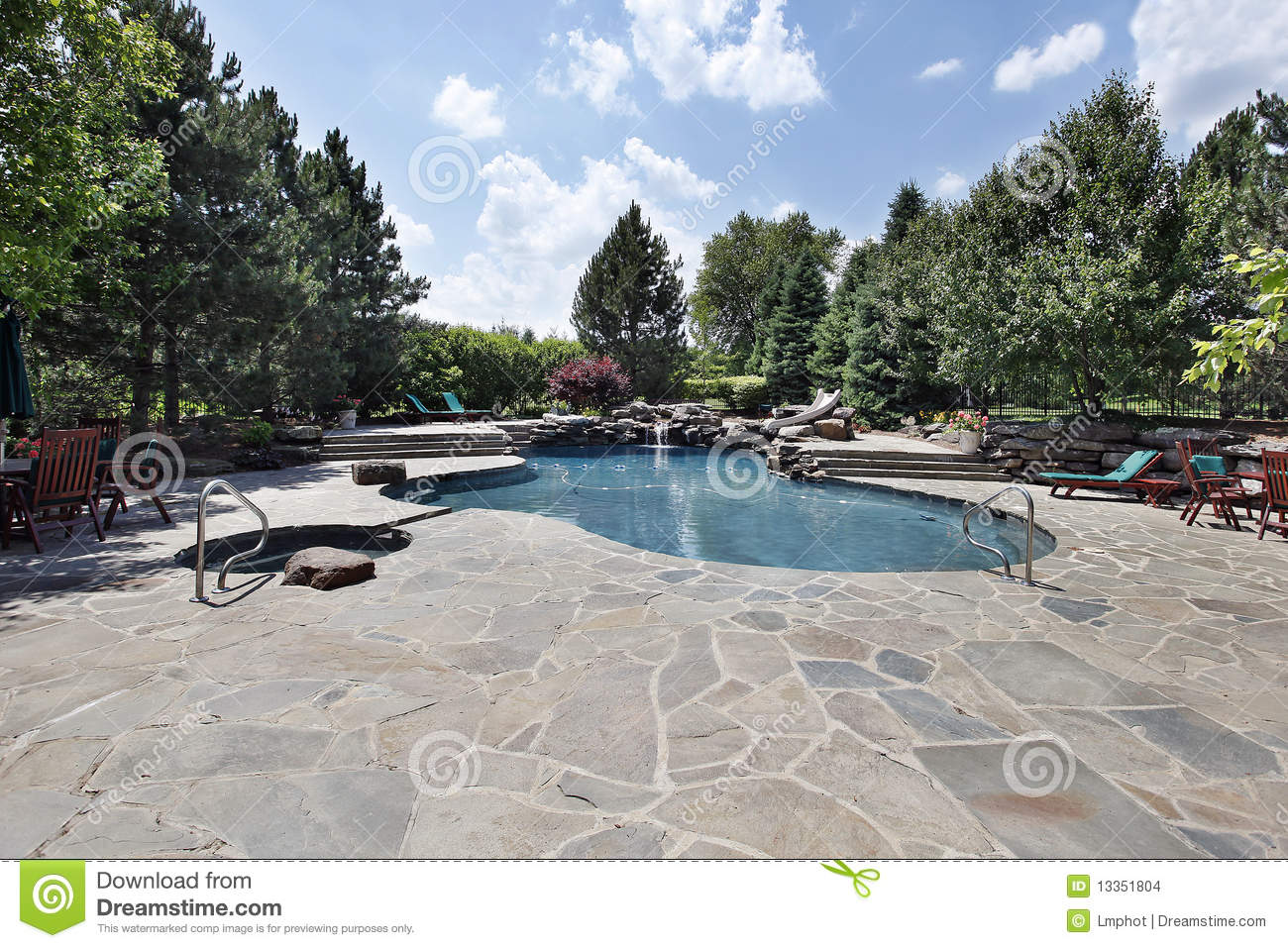 Swimming pool with large stone patio stock photo image for Stone swimming pool