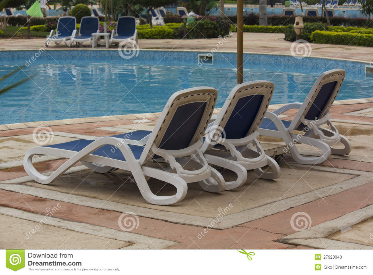 Swimming Pool Lounge Chairs Stock Photo - Image of ...