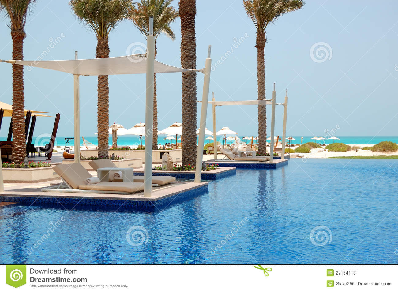 Swimming pool near beach at the luxury hotel stock photo for Luxury beach hotels