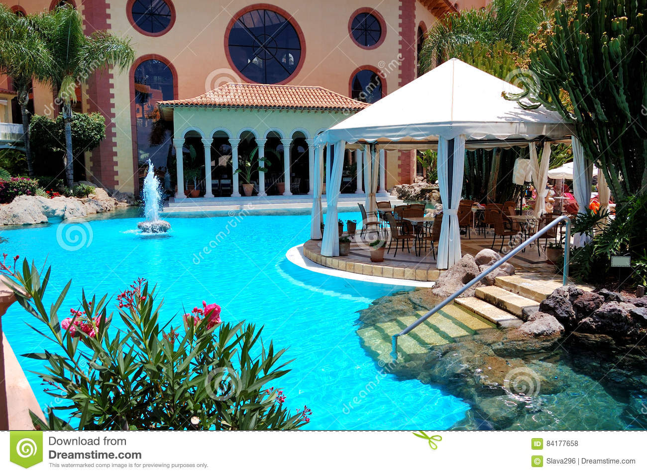 Swimming Pool And Outdoor Restaurant At Luxury Hotel Stock Photo