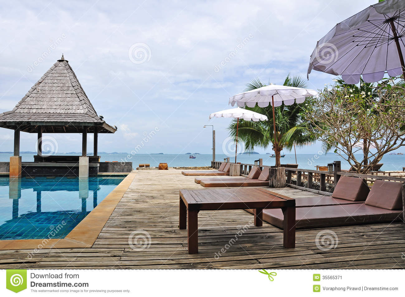 Swimming pool and pool bed with sea view background stock for Swimming pool bed