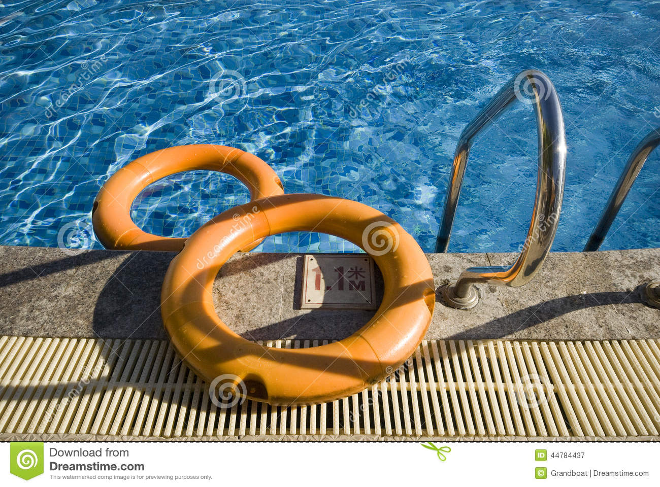 Rubber Swimming Pools : A swimming pool and rubber safety ring stock photo