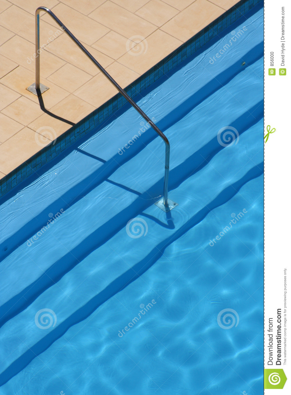 Swimming pool steps and rail stock photo image