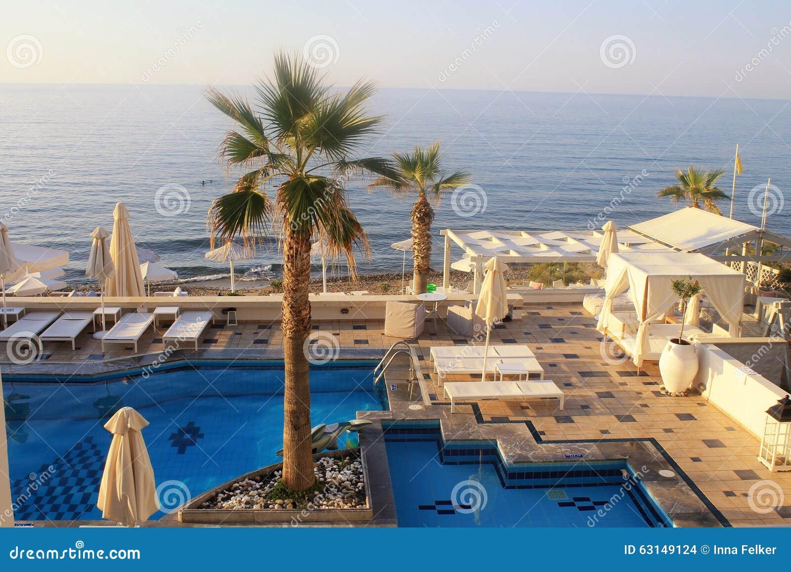 Swimming pool on summer sea resort crete greece stock for Design hotel crete
