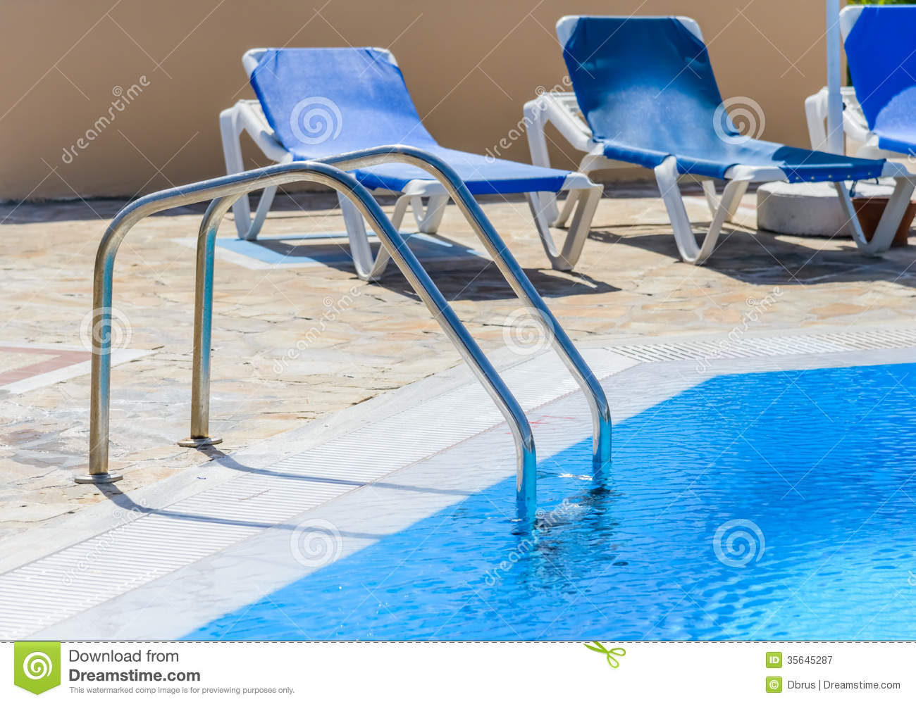 A swimming pool with sun loungers stock image image of for Swimming pool loungers