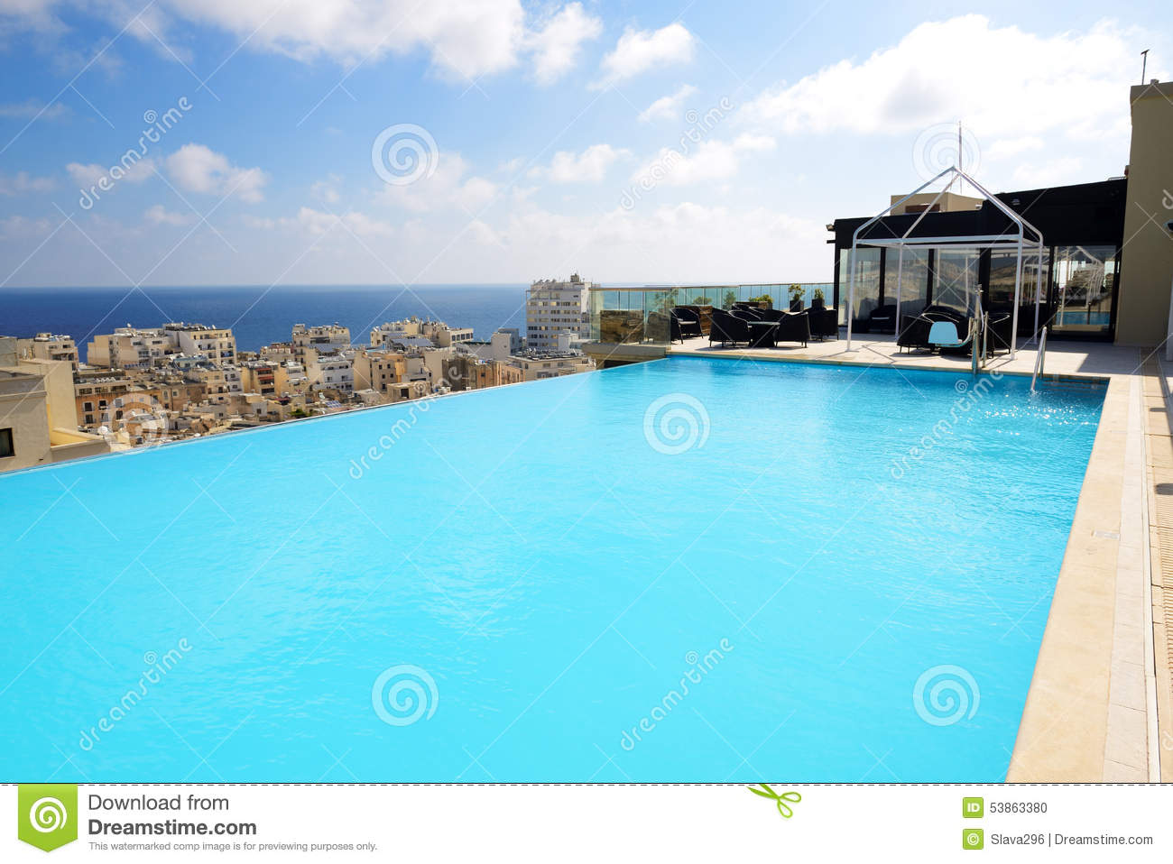 The swimming pool on the top of building stock photo - Swimming pool on top of skyscraper ...