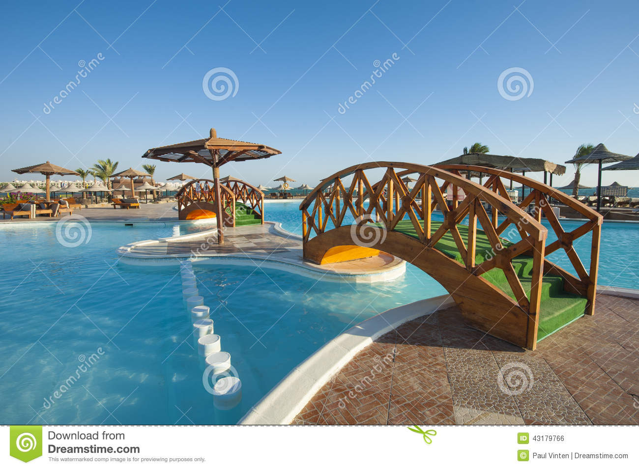 Swimming pool at tropical holiday resort stock photo - Holiday inn hotels with swimming pool ...