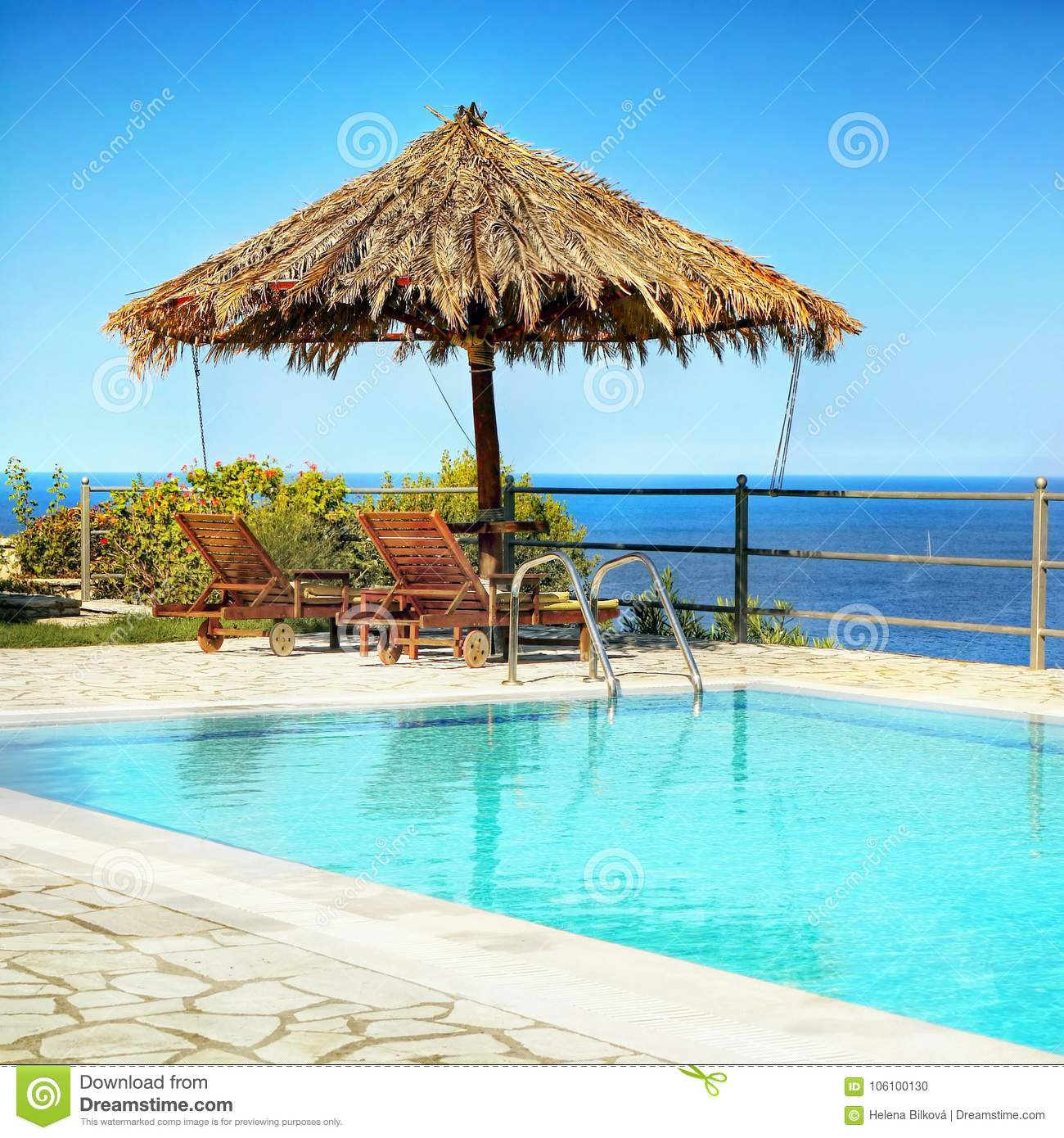 Swimming Pool Umbrella Loungers, Sea View Stock Photo ...