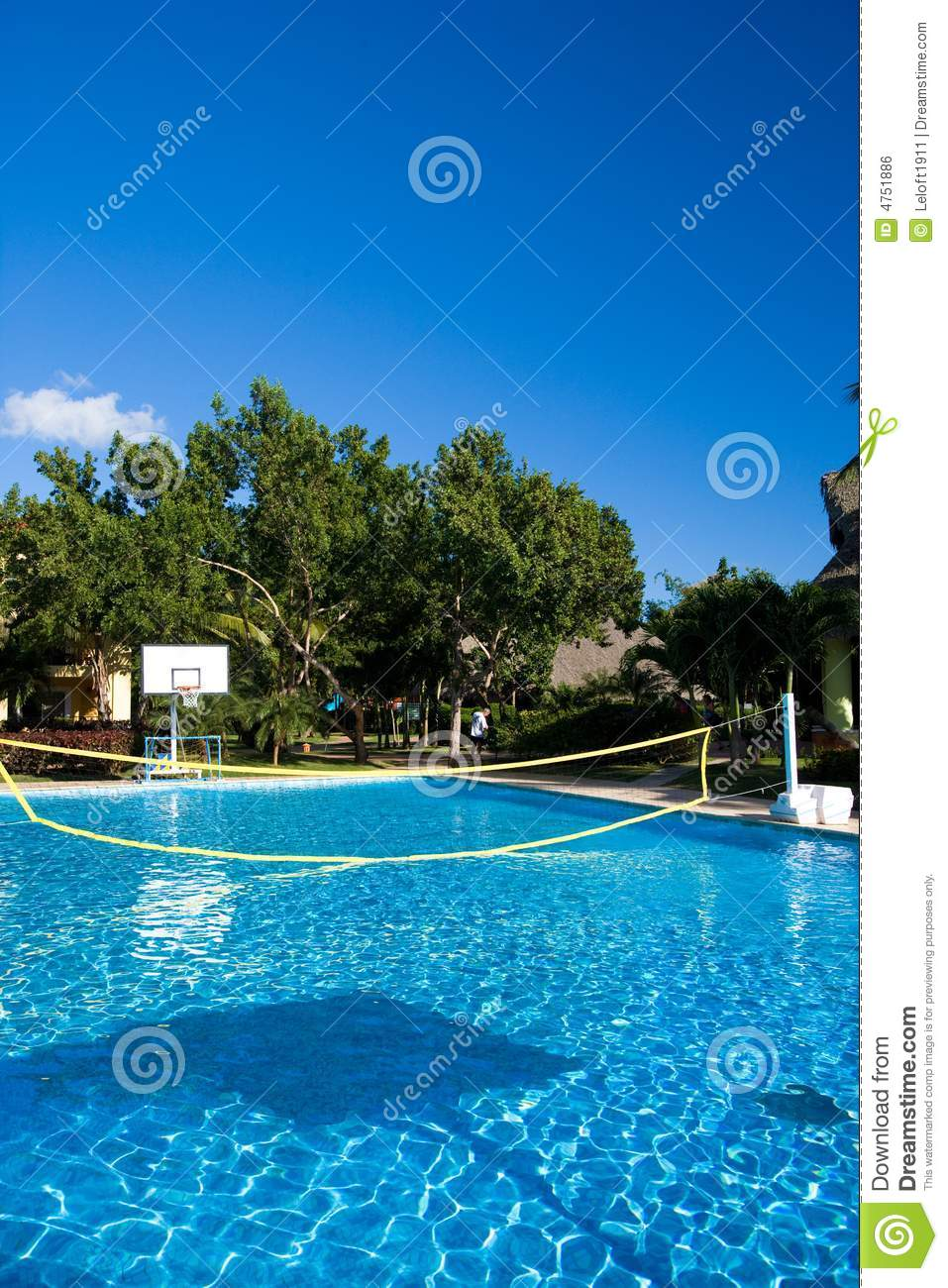 Swimming pool with a volleyball net at a resort in royalty for Pool design 974