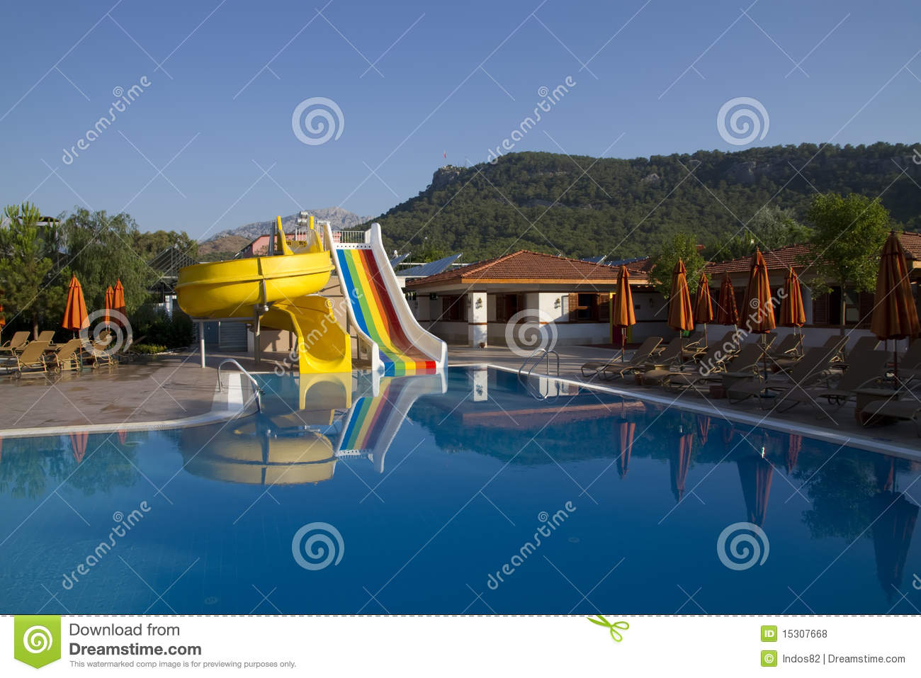 Swimming Pool With Water Slide Stock Photo - Image of ...